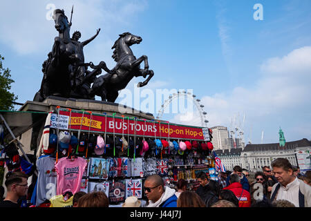 Tourists walk near Boadicea and Her Daughters sculpture on Westminster Bridge, London England United Kingdom UK - Stock Photo