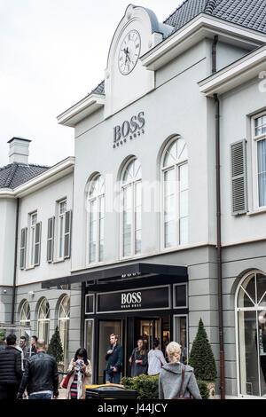 Roermond, Netherlands 07.05.2017 - Logo and shop of Hugo Boss Store Mc Arthur Glen Designer Outlet shopping area - Stock Photo