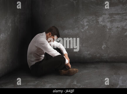 Alone desperate businessman. solitude and failure concept - Stock Photo