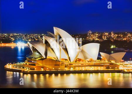 Sydney, Australia - 21 February 2016: Sydney Opera house iconic buiilding with bright illumination as seen from - Stock Photo