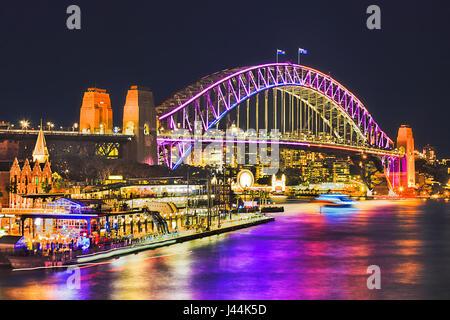Huge arch of Sydney Harbour Bridge brightly illuminated during annual light show Sydney vivid sydney festival. Overseas - Stock Photo