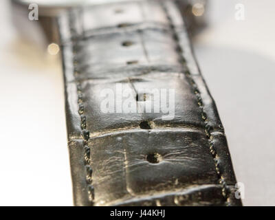 close up of black leather strap for watch on a white background macro - Stock Photo