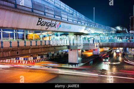 Traffic and Bangkok's Skytrain on Sukhumvit Road, Bangkok. - Stock Photo
