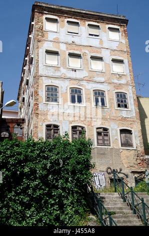 Buildings in Rua de Santa Barbara, Estafania quarter, buildings emptied and awaiting refurbishment or demolition, - Stock Photo