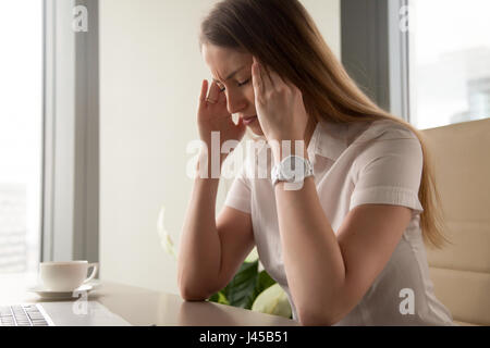 Businesswoman tries to cope with nervous tension - Stock Photo