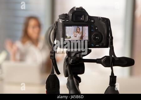 Recording business video on modern DSLR camera - Stock Photo