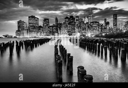 New York City skyline with wood pilings, black & white - Stock Photo