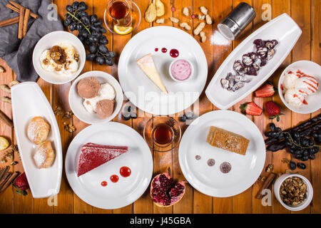 A lot of dessert on the wooden table. Georgian cuisine. Top view. Flat lay . Khinkali and Georgian dishes - Stock Photo