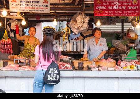 HO CHI MINH CITY, VIETNAM - FEBRUARY 07: Women are selling meat at the wet market on February 07, 2016 in Ho Chi - Stock Photo