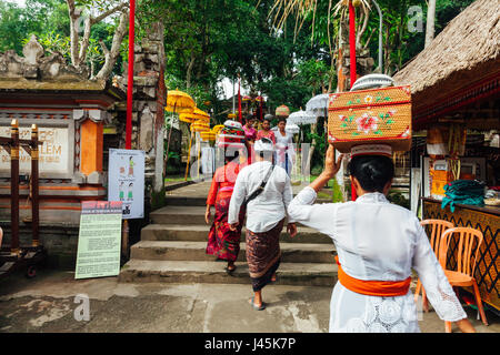 UBUD, INDONESIA - MARCH 2: People walks up the stairs during the celebration before Nyepi (Balinese Day of Silence) - Stock Photo