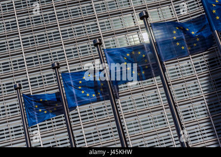Flags of European Union weaving outside the European Commission building, Brussels, Belgium - Stock Photo