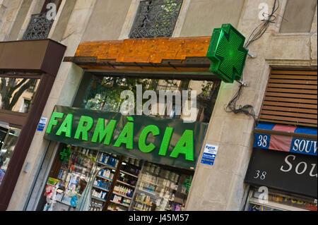 Exterior of Farmacia chemist shop on La Rambla in Barcelona Spain ES EU - Stock Photo