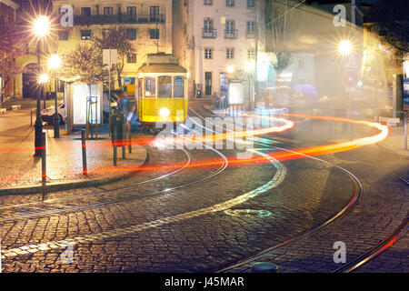 Yellow 28 tram in Alfama at night, Lisbon, Portugal - Stock Photo