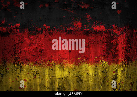 Germany flag painted on old ristic metal plate - Stock Photo