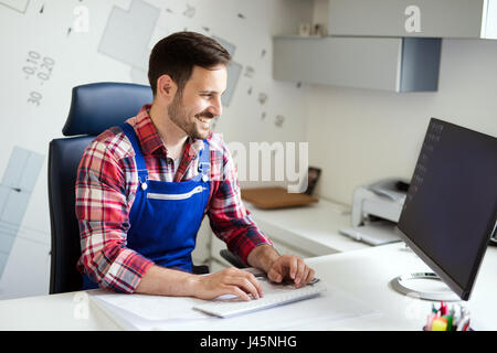 Mechanic at His Workplace doing His Daily Work Auto Repair Service in office - Stock Photo