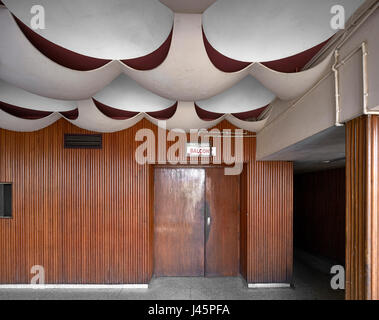 Foyer on upper level. Neelam Cinema Chandigarh, Chandigarh, India. Architect: Le Corbusier, 1954. - Stock Photo