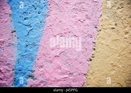 pink Grunge Background. Wall with the colored whitewash falling off fragment as a background texture - Stock Photo