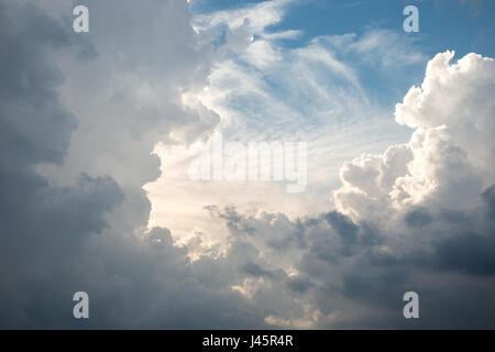 Beutiful cloudscape with white clouds against a blue sky - Stock Photo
