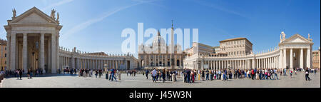 A 4 picture stitch panoramic view of St. Peter's Square in front of St Peters Basilica with crowds of tourists queing - Stock Photo