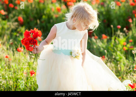 kids fashion, small girl, spring, wedding, happy childhood concept - lovely little blond kid wearing white dress - Stock Photo