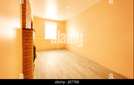 Empty room with window and turned on lights on the ceiling - Stock Photo