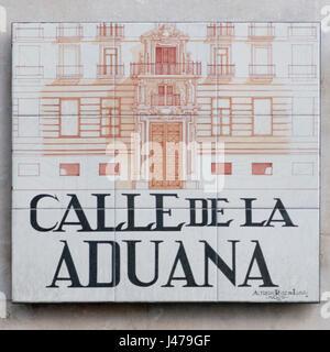 Calle de la Aduana (Customs street). Ceramic street sign in Madrid, Spain - Stock Photo