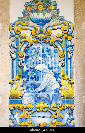 Portugal tiles, one of a series of 10 scenes in blue azulejos tiles depicting the Douro Valley port wine harvest - Stock Photo
