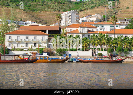Pinhao Portugal, traditional rabelo boats, now used for carrying tourists, moored on the Douro River along the Pinhao - Stock Photo