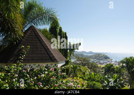 A pavillion surrounded by tropical foliage and a view of St. George's in the Hyde Park Garden above St. George's, - Stock Photo