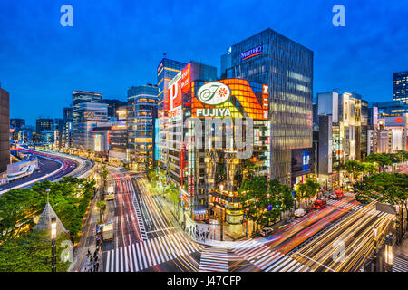 TOKYO, JAPAN - MAY 9, 2017: The Ginza district at night. Ginza is a popular upscale shopping area of Tokyo. - Stock Photo