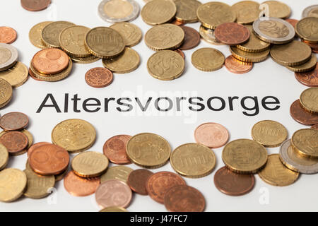 Altersvorsorge (pension plan in german) and Euro coins - Stock Photo