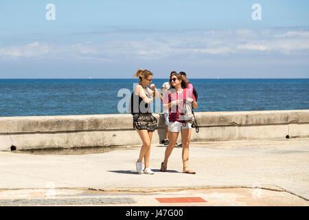 Two caucasian tourists walking in The Malecon, Havana, Cuba - Stock Photo