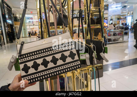The Kate Spade boutique within Macy's department store in New York with the Coach boutique behind it on Monday, - Stock Photo