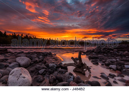 Beautiful sunset over the mountain river in summer - Stock Photo