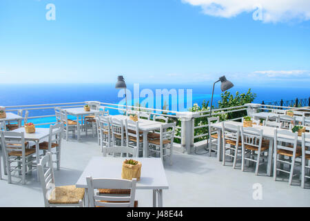 Luxury terrace balcony of exclusive seaside resort with fancy table and chairs fuit and flower bawl and full sea - Stock Photo
