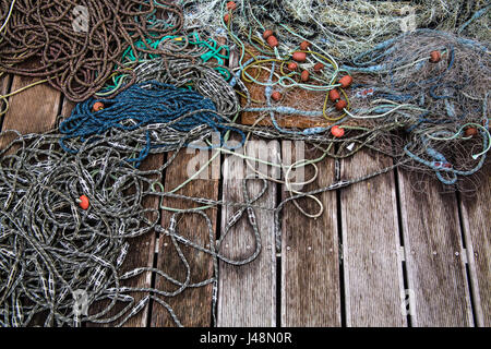 Ropes and fishing floats on a dock in Piran Slovenia - Stock Photo