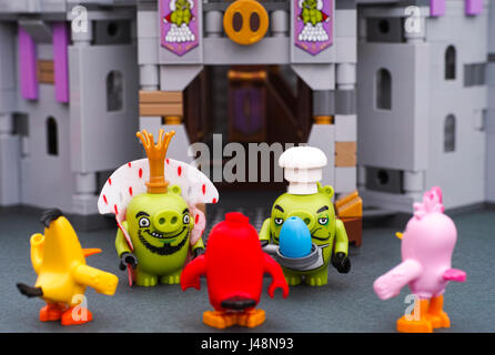 Tambov, Russian Federation - July 20, 2016 Lego King Pig and Chef Pig with pan and blue egg stand opposite to Angry - Stock Photo