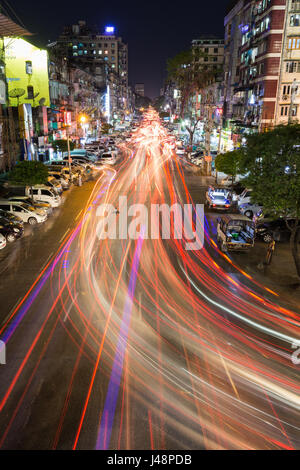 Light trails on the Anawrahta Road in Yangon (Rangoon), Myanmar (Burma) at night. - Stock Photo