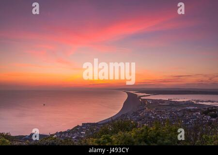 Portland, Dorset, UK. 10th May 2017.  A spectacular red sky at sunset viewed from Portland Heights looking across - Stock Photo