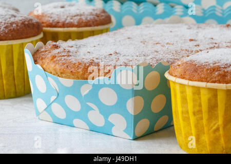 homemade carrot-cupcakes on wooden rustic table - Stock Photo
