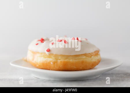 Single elegant donuts on plate - Stock Photo