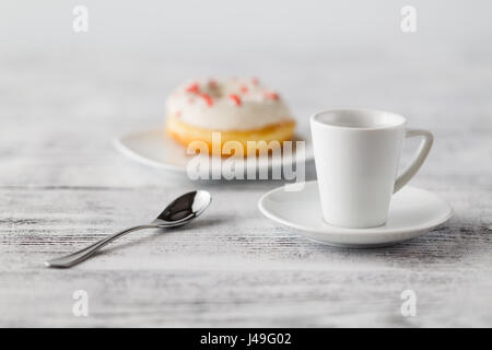 One iced donut on plate - Stock Photo