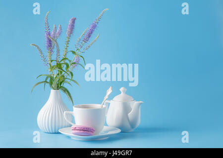 porcelain teacup and pink flowers - Stock Photo