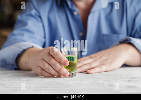 Drunk man is suit addicted to alcohol - Stock Photo