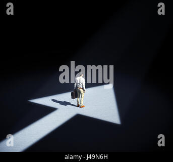 Man standing in a spotlight forming an arrow symbol - 3d illustration - Stock Photo