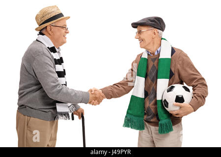 Two elderly football fans shaking hands isolated on white background - Stock Photo
