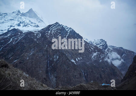 Looking at a range of mountains in the Himalayas. Annapurna Base Camp Trek. - Stock Photo