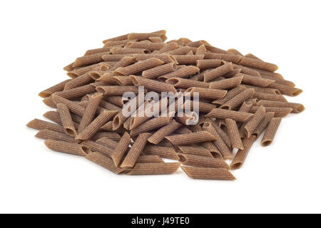 a pile of uncooked buckwheat penne rigate on a white background - Stock Photo