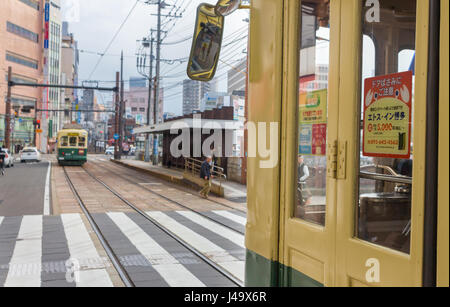 Nagasaki, Japan - March 26th, 2017: The Tram-train in Nagasaki operated by the Nagasaki electric tramway. - Stock Photo
