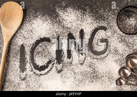 Handwritten word drawn in the flour - Icing - Stock Photo
